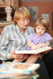 Grandmother and child reading  book Royalty Free Stock Images