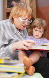 Grandmother and child reads  book Stock Image