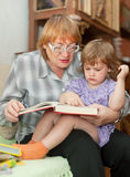 Grandmother and child reads  book Royalty Free Stock Image