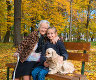 Grandmother and child sitting on the bench Royalty Free Stock Photos