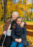 Grandmother and child sitting on the bench Royalty Free Stock Images
