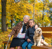 Grandmother and child sitting on the bench Stock Image