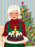 Grandmother and Christmas cake Stock Photography