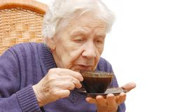 Grandmother and coffee royalty free stock photography