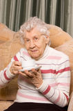 Grandmother from coffee on a sofa Royalty Free Stock Photos