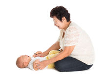 Grandmother comforting crying grandson. Stock Photo