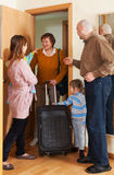 Grandmother coming to family. With two children home Royalty Free Stock Photography