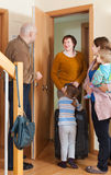 Grandmother coming to family  home. Grandmother with luggage coming to family with two children home Stock Photos