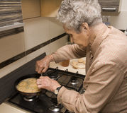 Grandmother at cooking. Senior lifestyle Royalty Free Stock Photo