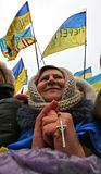 Ukraine, Kiev. Grandmother with a cross in hand to rallies. Grandmother with a cross in hand to rallies. The Ukrainian event on Maidan Square, a woman in a stock photo