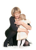 Grandmother cuddling little granddaughter. Stock Photography
