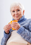 Grandmother with cup of tea. Grandmother with cup of ea on white isolated background Royalty Free Stock Photography