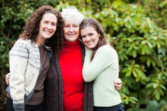 Grandmother, daughter and granddaughter. A multi generation portrait of a happy grandmother with her daughter and granddaughter Royalty Free Stock Photo