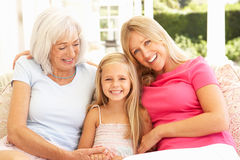 Grandmother, Daughter And Granddaughter Relaxing. Portrait Of Grandmother, Daughter And Granddaughter Relaxing On Sofa Stock Images