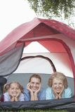 Grandmother, Daughter And Granddaughter Smiling From Tent Stock Images