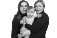 Grandmother, daughter and granddaughter on white portrait, happy family concept stock photo