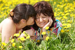 Grandmother with daughter in outdoor. stock image
