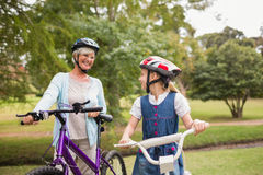Grandmother and daughter on their bike Stock Photo