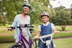Grandmother and daughter on their bike Stock Photos