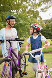 Grandmother and daughter on their bike Stock Photography