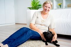 Grandmother with a dog Stock Photography