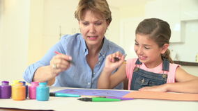Grandmother Drawing Picture With Granddaughter At Home stock video