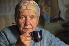 Russia, Moscow, June 9, 2018, grandmother drinking tea, editorial stock photos