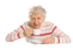 Grandmother drinks coffee Royalty Free Stock Photos