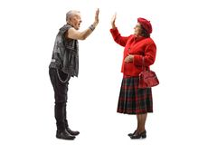 Grandmother and elderly punker gesturing high-five. Full length shot of a grandmother and elderly punker gesturing high-five isolated on white background royalty free stock photos