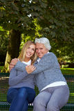Grandmother embracing grandchild Stock Images