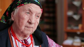 Grandmother in embroidery. Ukrainian national clothes HD stock footage