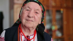 Grandmother in embroidery. Ukrainian national clothes HD stock video footage