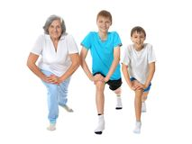 Grandmother exercising with two boys Royalty Free Stock Images
