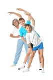 Grandmother exercising with two boys Royalty Free Stock Photo