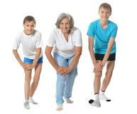 Grandmother exercising with two boys Royalty Free Stock Image
