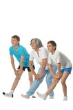 Grandmother exercising with two boys Stock Images