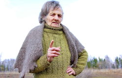 Grandmother faces finger Royalty Free Stock Image