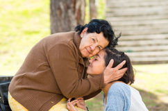 Grandmother facing granddaughter touching heads Royalty Free Stock Photography