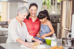 Grandmother with family making bread Stock Photos