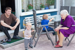 Grandmother, father and two toddler boys in summer Royalty Free Stock Images