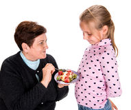 Grandmother Feeds Strawberry To Her Granddaughter Royalty Free Stock Images