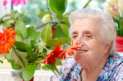 Grandmother with flowers Royalty Free Stock Images