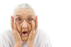 Funny grandma. Grandmother with funny expressions ona n isoltaed background royalty free stock photography