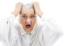 Neurotic grandma. Grandmother with funny expressions ona n isoltaed background Royalty Free Stock Photos