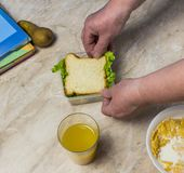 Grandmother gathers lunch for the child in school sandwich stock photo