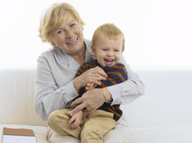 Grandmother getting a kiss from grandson Royalty Free Stock Image