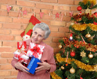 Grandmother with gifts stock photography