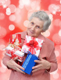 Grandmother with gifts Royalty Free Stock Images