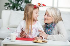 Grandmother And Girl With Cardpaper Looking At Royalty Free Stock Images