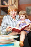 Grandmother and girl reads book Stock Photo